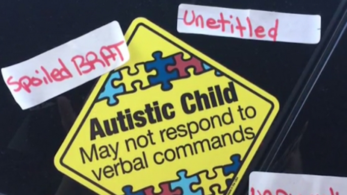 Autism Awareness Sign Vandalized With Offensive Stickers